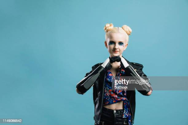 inspiring teenage girl with robotic arms - amputee girl stock pictures, royalty-free photos & images