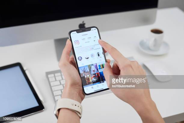 instagram application on apple iphone x - auto post production filter stock pictures, royalty-free photos & images