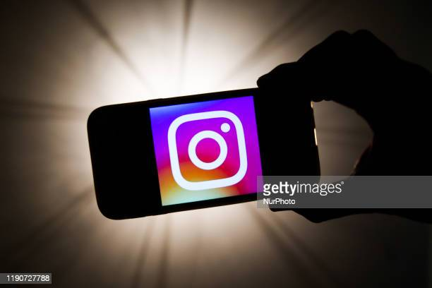 Instagram logo is seen displayed on a phone screen in this illustration photo taken in Krakow, Poland on December 27, 2019.