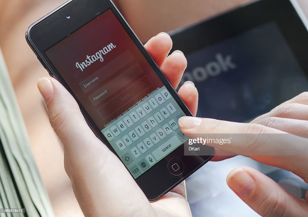 Instagram on an Iphone : Stock Photo