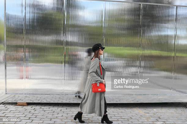Instagramer Andreia Moreira wearing jacket HM body and trousers from Zara glasses and boots from Stradivarius and bonnet from Pull and Bear during...