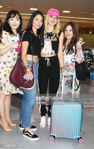 Instagrammer/entrepreneur Chiara Ferragni poses with fans as she arrives at Narita International Airport on July 10 2019 in Narita Japan