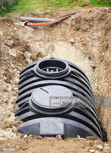 installation of a septic tank - septic tank stock photos and pictures