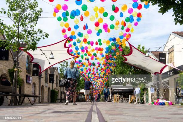 Installation of colourful balloons by Portuguese artist Patricia Cunha on display at Cour St Emilion at Bercy Village in Paris on June 18 2019 /...