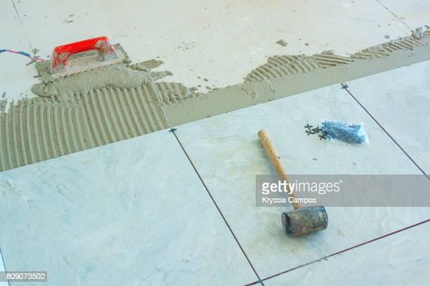 Installation of New Tiles on a Bathroom Floor