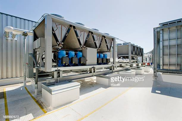 hvac installation with chillers and compressors - cooling tower stock pictures, royalty-free photos & images