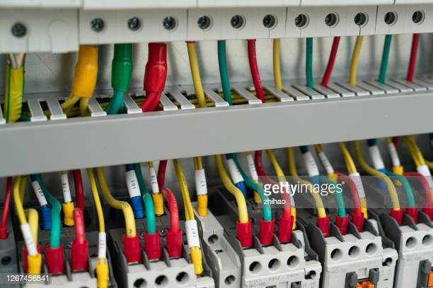 installed wires in the electrical control cabinet - electrical panel box stock pictures, royalty-free photos & images
