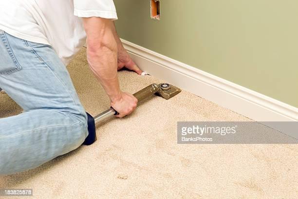 Installer Using Knee Kicker to Stretch Bedroom Carpet