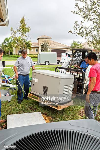 installing an whole house emergency generator for hurricane season - generator stock pictures, royalty-free photos & images