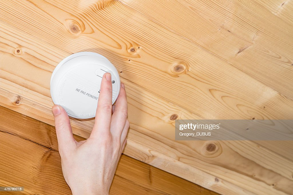 Installing And Testing Wood Ceiling Mounted Home Smoke Detector