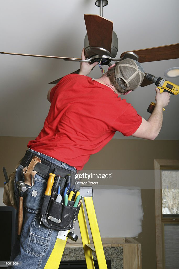Installing Ceiling Fan High-res Stock Photo