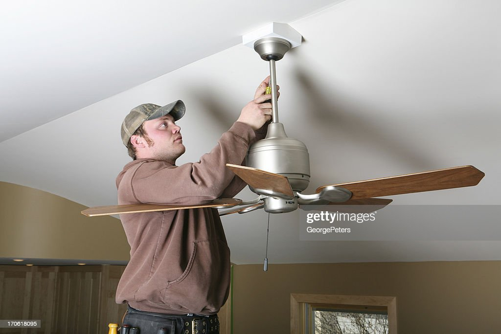 Installing ceiling fan stock photo getty images installing ceiling fan stock photo mozeypictures Image collections