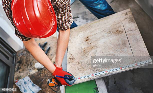 Installing ceramic tiles.