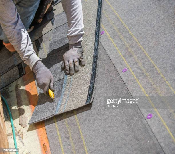 installing new roof. cutting tile. - utility knife stock pictures, royalty-free photos & images