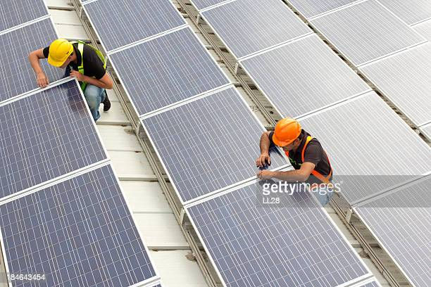 installing panels - solar powered station stock pictures, royalty-free photos & images