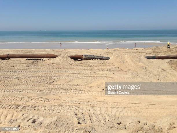 Installing pipes on the beach