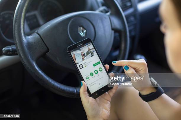 installing the uber app - sharing economy stock pictures, royalty-free photos & images