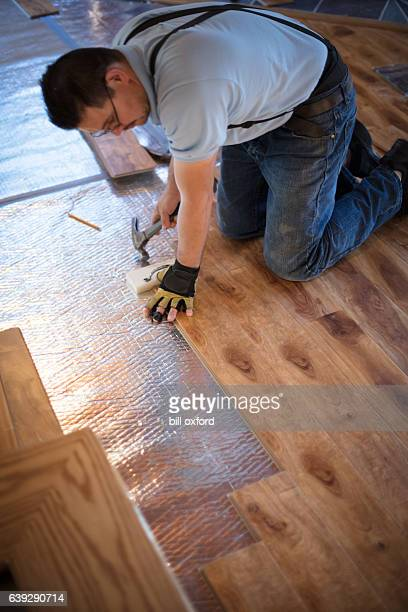 installing wood flooring - laminate flooring stock pictures, royalty-free photos & images