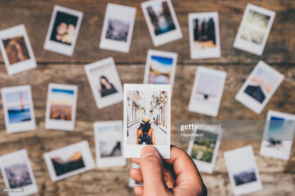 Instant camera prints on a table : Stock Photo