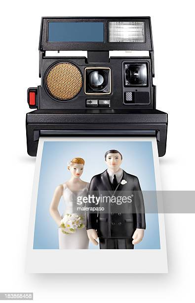 Instant for life. Photo of wedding cake topper.