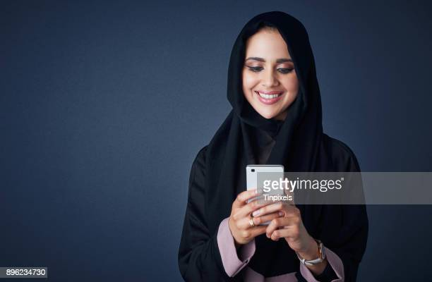 instant messaging, the fastest way to stay in touch - muslim woman darkness stock photos and pictures