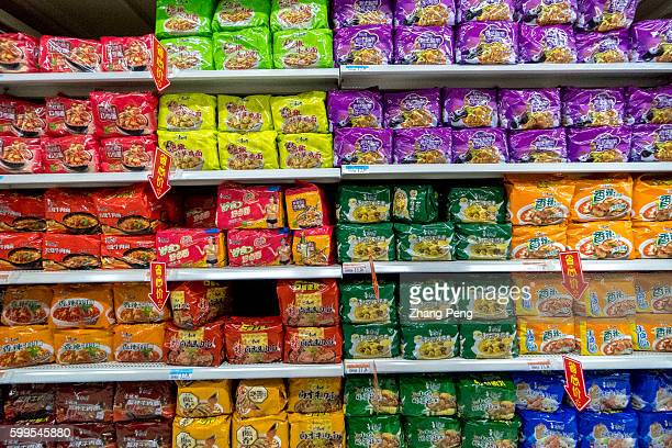 Instant noodle products of Master Kong in a supermarket Chinese food and beverage maker Tingyi pronounced an 87 percent plunge in quarterly profit...
