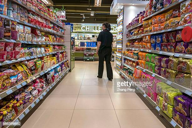 Instant noodle shelves in a supermarket Chinese consumer spending on fast moving consumer goods in the second quarter grew 46 percent from a year ago...