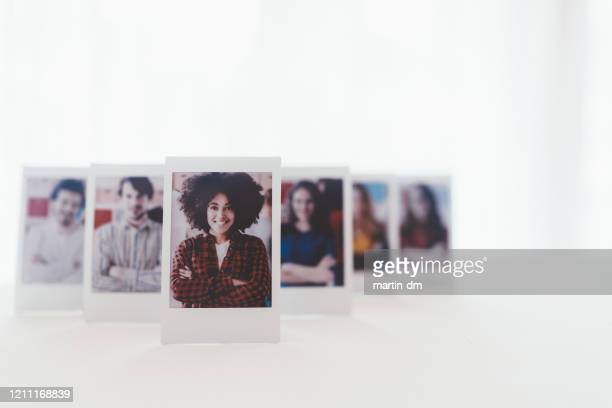 instant photos of successful business team - alumni stock pictures, royalty-free photos & images