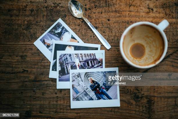 instant photos of woman on cafeteria table - transfer image stock pictures, royalty-free photos & images
