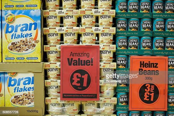 Instant porridge and baked beans manufactured by The Kraft Heinz company sit on display at a Poundland Group Plc store in Leigh UK on Thursday Feb 4...