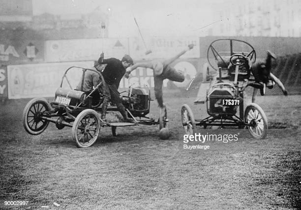 Instead of Horses Cars carry mallet wielding Competitors in a Game of Polo in an arena on Coney Island New York