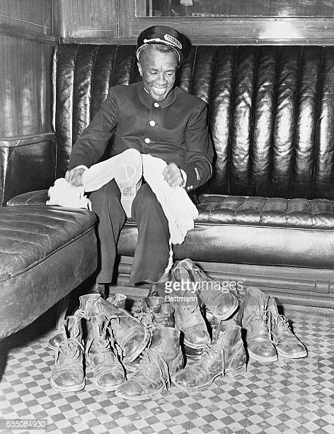 8/18/1942 Instead of peeling spuds its rubbing soliders' shoes that keeps Pullman porter Parish Jones so busy while troops back in the car are asleep...