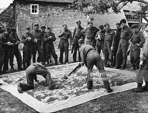 Instruction with the aid of a giant relief map at the South Eastern Army Fieldcraft School in England 1942