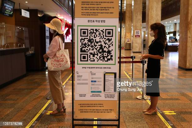 Instructions and QR code for SafeEntry contact tracing is displayed amid coronavirus at a Sejong Culture Center for ahead of musical 'Mozart' on July...