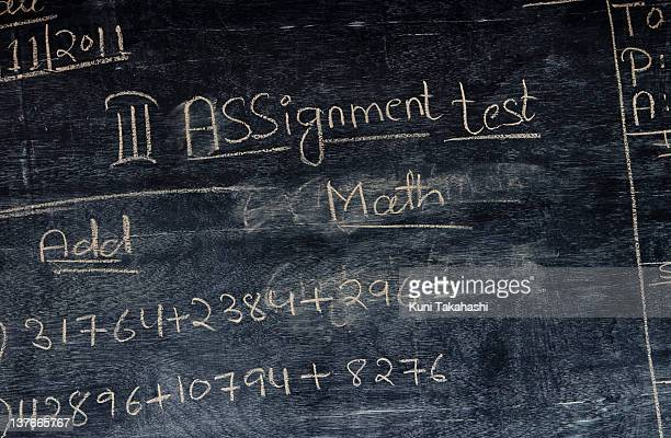Instructions are written on a chalk board at M.A. Idial School, a private school, on November 25, 2011 in Hyderabad, India. The government's recent...