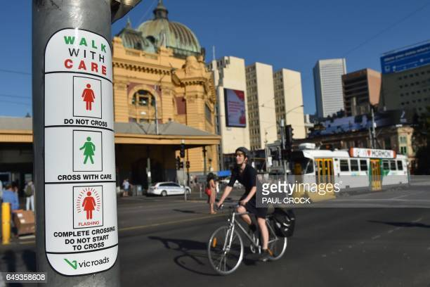 Instructions for new pedestrian traffic signals designed to equal the gender balance are displayed on a pole near Flinders Street railway station on...