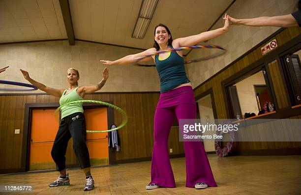 Instructor Allison Miller right and student Rebekka Armstrong participate in a hula hoop class at the Carmichael Recreation Department in Carmichael...