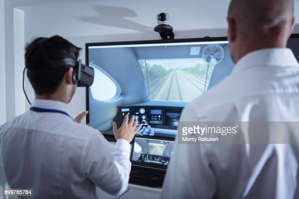 Instructor and apprentice using Virtual Reality system in railway engineering facility