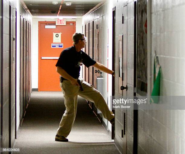 Instructor Bret Bandick tries to kick a door down while he acts as an active shooter at the Olmeca Residence Hall at San Diego State January 8 2013...