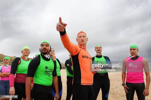 Instructor Brett Walker speaks with Garie Vanguard Surf Life Saving trainees about surf conditions during a training session at Elouera Beach on...