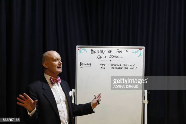 Instructor James Lovell teaches student Santas during a training session at The Ministry of Fun Santa School in London on November 16 2017 Pens at...