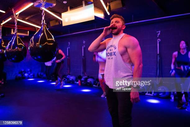 Instructor Jay Brown leads the first class at the reopening of KOBOX Chelsea on July 25 2020 in London England Gyms swimming pools and indoor leisure...