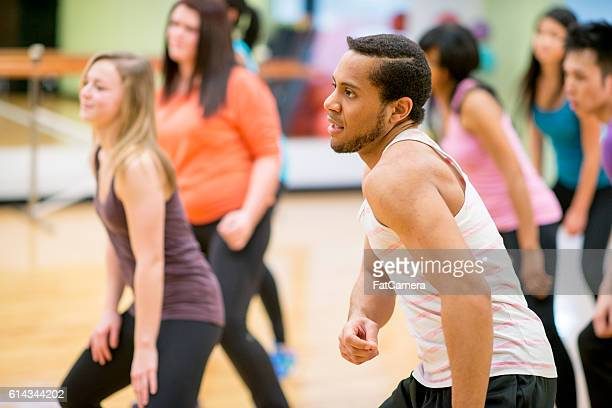Instructor Leading a Dance Class