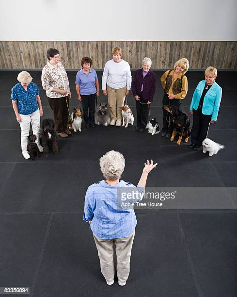 Instructor leading dog obedience class