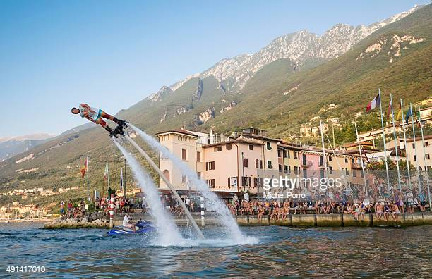 Instructor Marco Amico gives a flyboarding demonstration on Lake Garda on August 29 2015 in Brenzone Italy Flyboarding is a new extreme watersport...