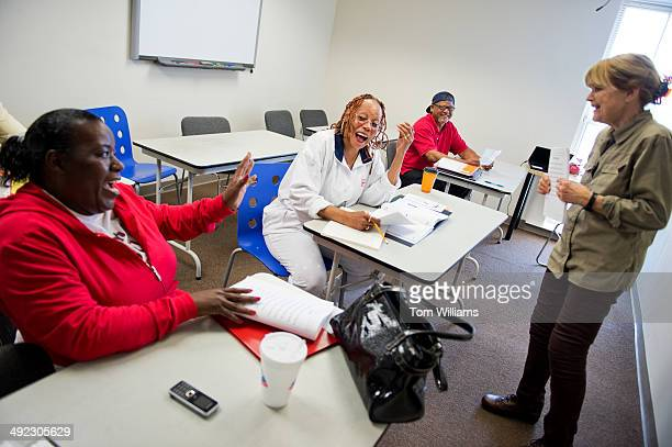 Instructor Martha Tansey conducts a reading class with students Denise Herbert center Donna Snowden red and Allen Wright at the Washington Literacy...