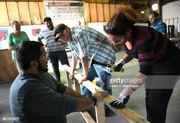 Instructor Moses Alvarez left teaches the finer points of building concrete forms to students Rafelina Garibay right and Andrew Parker middle during...