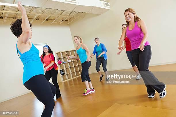 Instructor teaching women in fitness class