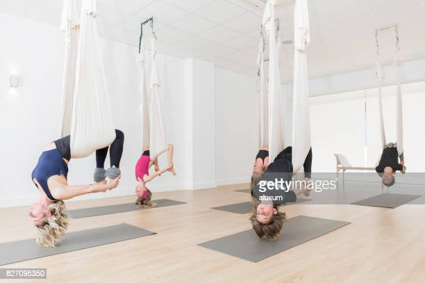 Instructor with children in aerial yoga class