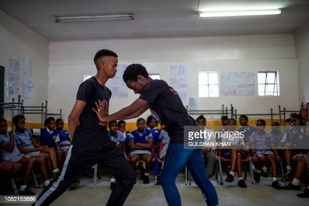 Instructors Ashlyn Tachuana and Letlhogonono Keohitlhetse demonstrate self defence methods during a session with NGO Action Breaks Silence called...